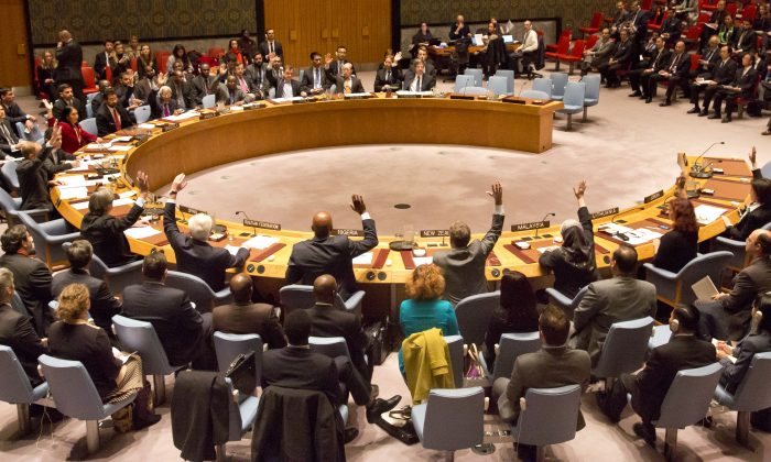 U.N. Security Council members vote on a French-sponsored counter terrorism resolution aimed at Islamic extremist, Friday, Nov. 20, 2015 at United Nations headquarters. (AP Photo/Bebeto Matthews)