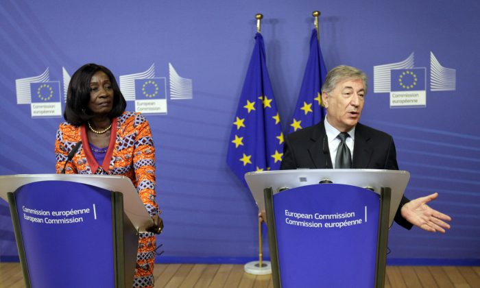 European Union Commissioner for Fisheries Karmenu Vella (R) and Ghana's Minister of Fisheries Sherry Ayittey participate in a media conference at EU headquarters in Brussels on Friday, Dec. 18, 2015.  (AP Photo/Francois Walschaerts)