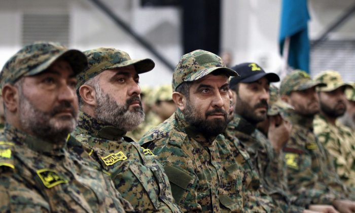 Hezbollah terrorists listen to Hezbollah leader Sheik Hassan Nasrallah, as he speaks via a video link during a rally to mark the Hezbollah martyr day, in the southern suburb of Beirut, Lebanon, on Nov. 11, 2015. (AP Photo/Bilal Hussein)