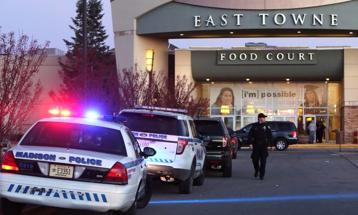 "Authorities respond to reports of shots fired at East Towne Mall in Madison, Wis., Saturday, Dec. 19, 2015. Madison police said one person was shot in the leg during a ""disturbance"" inside the mall but his injuries are not life threatening. (Amber Arnold/Wisconsin State Journal via AP)"