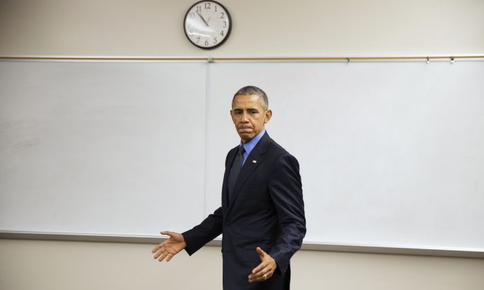 President Barack Obama delivers a statement at Indian Springs High School after meeting with families affected by the shootings in San Bernardino, Calif., on Friday, Dec. 18, 2015, in San Bernardino. (AP Photo/Evan Vucci)