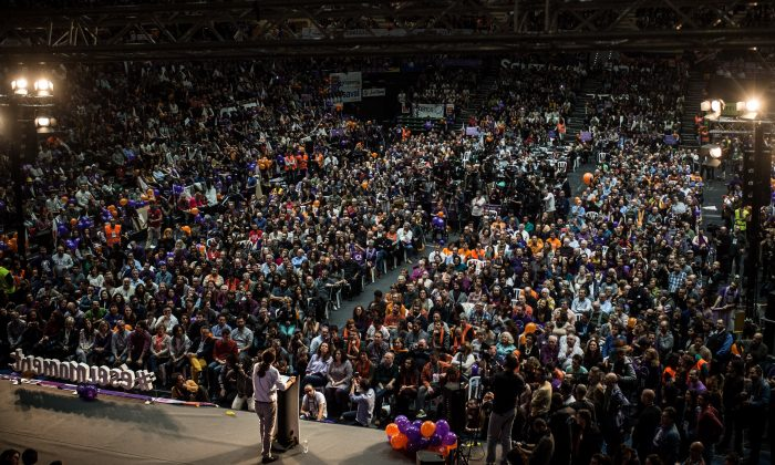 Podemos (We Can) leader Pablo Iglesias delivers his speech during the closing campaign rally in Valencia, Spain, on Dec. 18, 2015. Over 36 million Spaniards will flock to the polls on Sunday, Dec. 20, 2015, to vote for 350 members of the parliament and 208 senators. For the first time since 1982, the two traditional Spanish political parties, right-wing Partido Popular (People's Party) and center-left wing Partido Socialista Obrero Espanol PSOE (Spanish Socialist Workers' Party), are holding a tight election race with two new contenders, Ciudadanos (Citizens) and Podemos (We Can) attracting right-leaning and left-leaning voters respectively. (David Ramos/Getty Images)