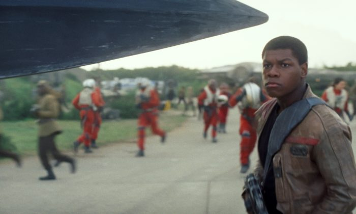 """John Boyega as Finn in a scene from the new film """"Star Wars: The Force Awakens,"""" directed by J.J. Abrams. The movie was released in the U.S. on Friday, Dec. 18, 2015. (Film Frame/Disney/Lucasfilm via AP)"""