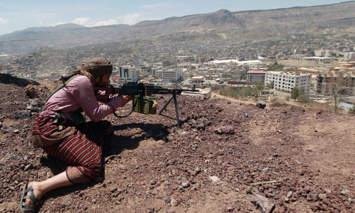A Yemeni Shiite Houthi anti-government rebel holds a position at an army base which they captured without resistance just hours before the signing a UN-brokered peace agreement on Sept. 22, 2014, in the Yemeni capital, Sanaa. The hard-won deal, signed the day before by the president and all the main political parties, is intended to end a week of deadly fighting in Sanaa between the rebels and their opponents, and put the country's troubled transition back on track. (Hohammed Huwais/AFP/Getty Images)
