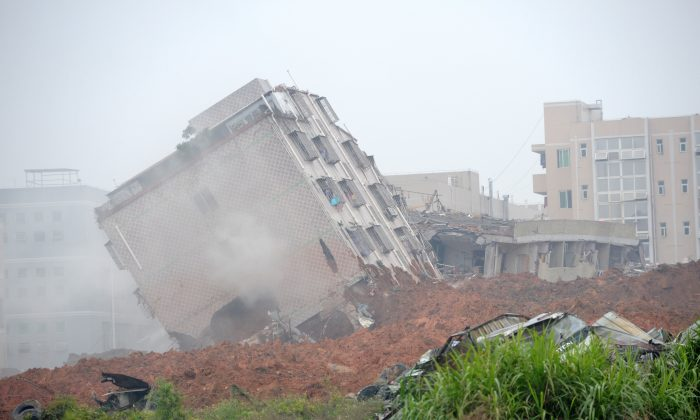 A building tilts dangerously after a landslide hit an industrial park in Shenzhen, south China's Guangdong province on Dec. 20, 2015. (STR/AFP/Getty Images)