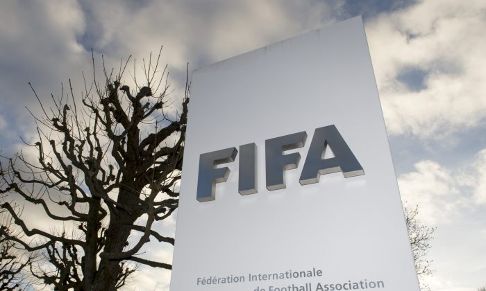 The FIFA logo is pictured outside the FIFA headquarters in Zurich, Switzerland, on Dec. 17, 2015. While FIFA President Sepp Blatter will appear in person on Thursday before the panel of four judges of the FIFA ethics court, UEFA President Michel Platini plans to boycott his hearing on Friday Dec. 18. Blatter and Platini were banned for 90 days for all activities in football. (Walter Bieri/Keystone via AP)