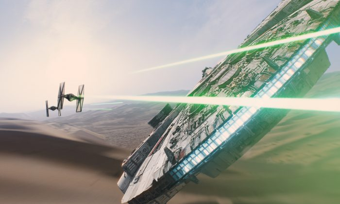 """The Millennium Falcon piloted by Rey (Daisy Ridley) pursued by First Order tie-fighters in """"Star Wars: The Force Awakens"""" (2014 Lucasfilm Ltd./Walt Disney Studios Motion Pictures)"""