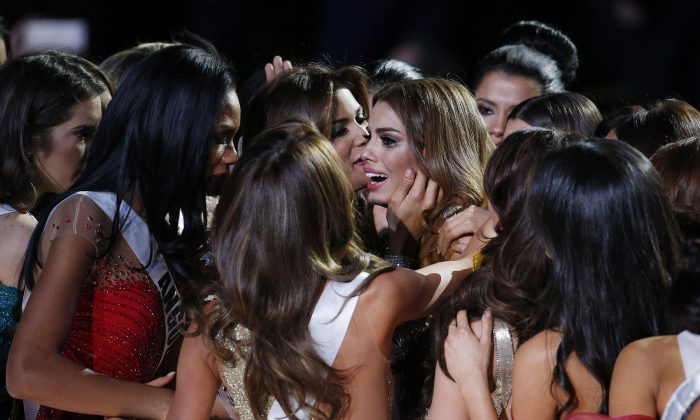 Other contestants comfort Miss Colombia Ariadna Gutierrez, center, after she was incorrectly crowned Miss Universe at the Miss Universe pageant on Sunday, Dec. 20, 2015, in Las Vegas. Miss Philippines Pia Alonzo Wurtzbach was named Miss Universe. (AP Photo/John Locher)