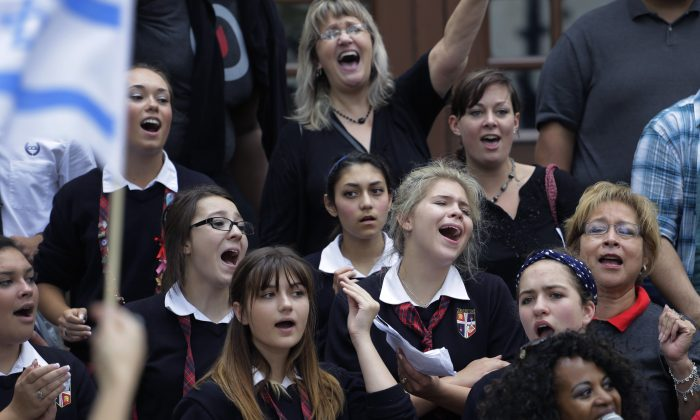 Cornerstone Christian School students sing during a National Day of Prayer event at City Hall, Thursday, May 7, 2015, in San Antonio. (AP Photo/Eric Gay)