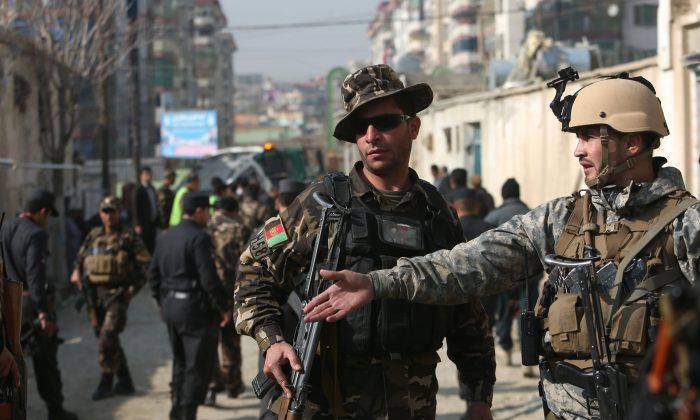 Afghan security forces inspect the site of a suicide attack in Kabul, Afghanistan, on Nov. 28, 2015. (AP Photo/Rahmat Gul)