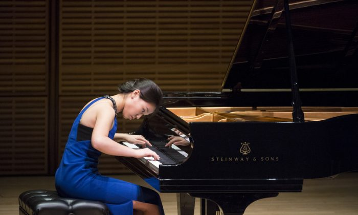 Aileen Gozali on stage at Carnegie Hall Oct. 5 during the Future Stars Recital as part of the  2014 NTD International Piano Competition, which drew contestants from 11 countries and territories as far away as Egypt and China. (Dai Bing/Epoch Times)