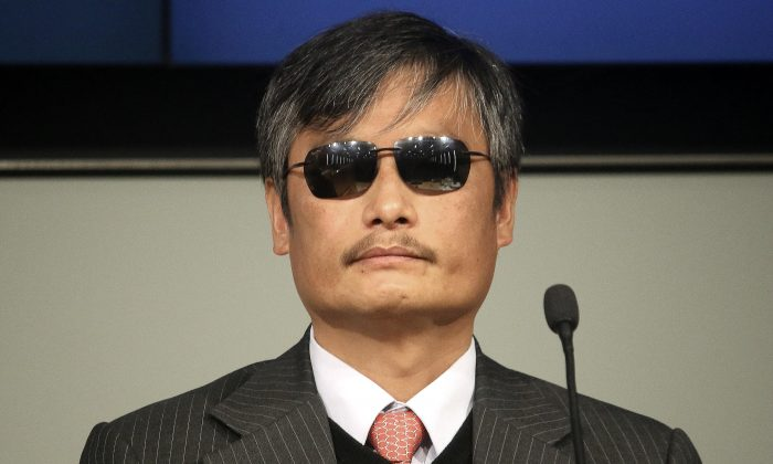 "Chen Guangcheng, visiting fellow at Catholic University of America, speaks at a forum on ""The Deteriorating State of Human Rights in China,"" at the Cato Institute, on Nov. 23, 2015. Chen is a blind legal advocate and activist who is best known for exposing the abuses of China's population planning officials, including forced abortions and sterilizations. (Gary Feuerberg/Epoch Times)"