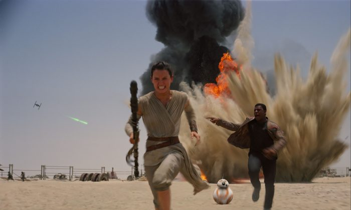 """Daisey Ridley as Rey (L) and John Boyega as Finn, in a scene from the new film, """"Star Wars: Episode VII - The Force Awakens,"""" directed by J.J. Abrams. The movie releases in the U.S. on Dec. 18, 2015. (Film Frame/Disney/Copyright Lucasfilm 2015 via AP)"""