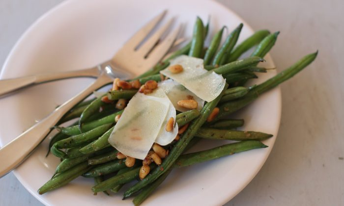 This Nov. 9, 2015, photo, shows green beans with anchovies, Parmesan and pine nuts in Concord, N.H. This recipe is by Melissa D'Arabian. (AP Photo/Matthew Mead)