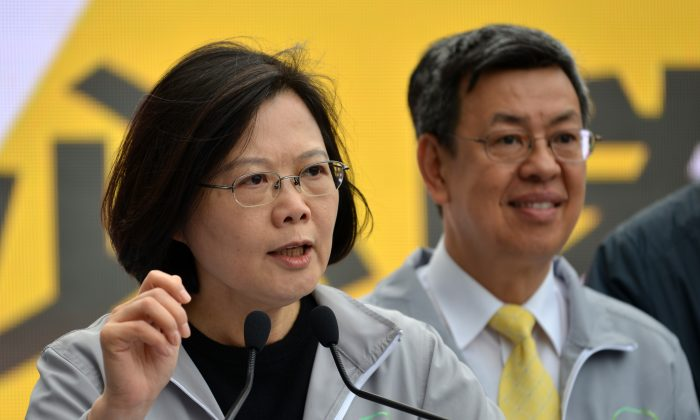 Tsai Ing-wen (L), chairwoman from Taiwan's main opposition Democratic Progressive Party (DPP) and the party's candidate for in the upcoming presidential election, speaks at an event in Taipei on Dec. 20. The Chinese Communist Party has been threatening Taiwan over the expected victory of the DPP, which favors Taiwanese independence. (Sam Yeh/AFP/Getty Images)
