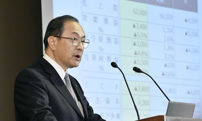 Toshiba Corp. President Masashi Muromachi at a press conference at the company's headquarters in Tokyo on Dec. 21, 2015. Scandal-plagued Japanese manufacturer Toshiba is cutting 7,800 jobs after projecting a net loss of 550 billion yen ($4.5 billion) for the fiscal year through March 2016. Toshiba said Monday it will slash the jobs in its personal computer, video product and consumer electronic businesses. (Shigeyuki Inakuma/Kyodo News via AP)