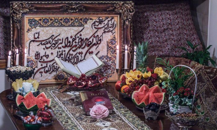 The Yalda table setting consists of Quran, Divan-e-Hafez (Poems of Hafez), fruits and Ajeel (dried fruits). (Mohammed Reza Amirinia)