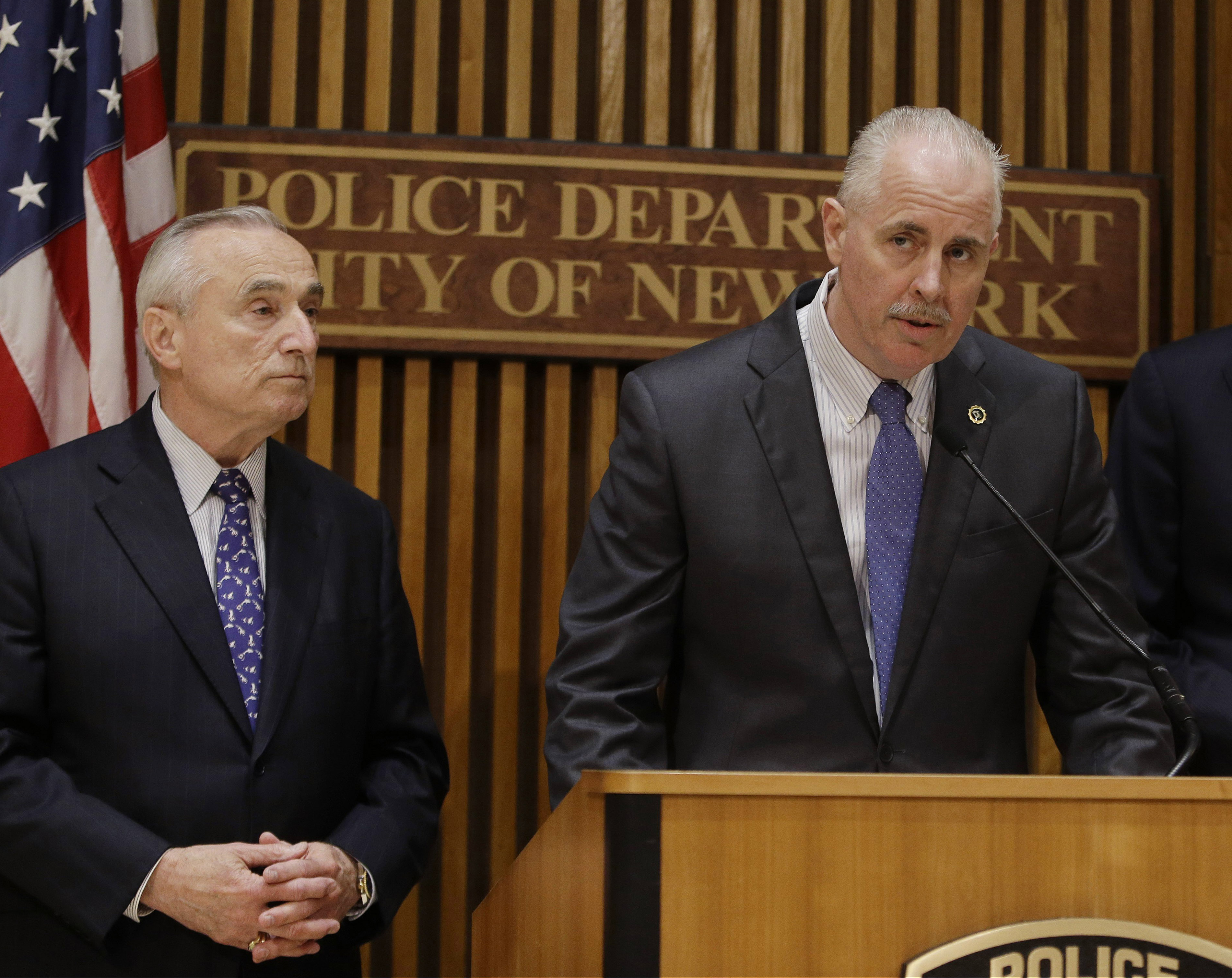 New York Police Chief of Detectives Robert Boyce speaks to the media as Police Commissioner William J. Bratton (l) looks on, in New York, on June 4, 2014. Although outlaw street gangs are engaging in more of a white-collar variety of crime, they are not shifting away from violence. In an interview with The Associated Press, Boyce recently said that,