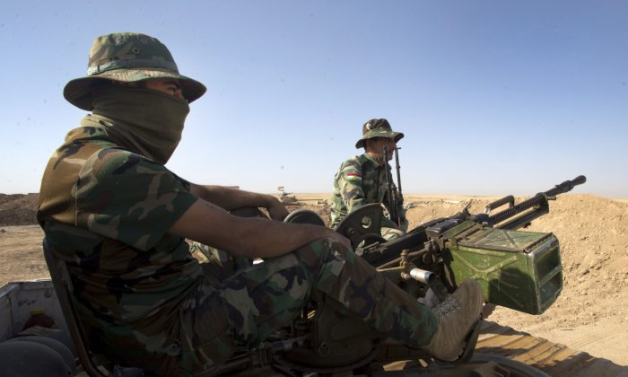 Peshmurga soldiers man their positions at the front line in the fight against ISIS on Sept. 4, 2014, in Kalak, Iraq. (The Canadian Press/Ryan Remiorz)