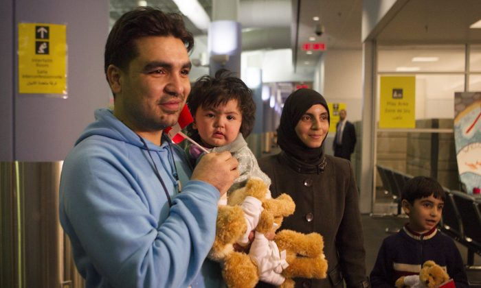 A family of Syrian refugees arrives at the Welcome Centre at Toronto's Pearson Airport on Dec. 18, 2015. Social media is playing a key role in community organizing as 25,000 refugees arrive in Canada over the next few months. (The Canadian Press/Chris Young)