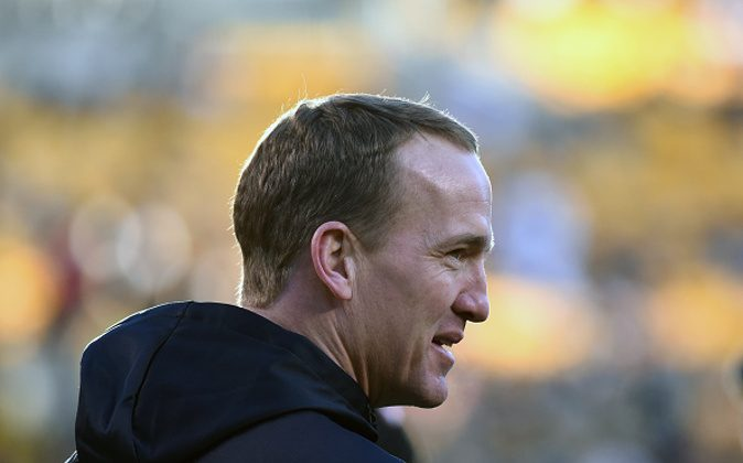 PITTSBURGH, PA - DECEMBER 20: Injured quarterback Peyton Manning of the Denver Broncos looks on from the sideline during pregame warmup prior to a game against the Pittsburgh Steelers at Heinz Field on December 20, 2015 in Pittsburgh, Pennsylvania. The Steelers defeated the Broncos 34-27. (Photo by George Gojkovich/Getty Images)