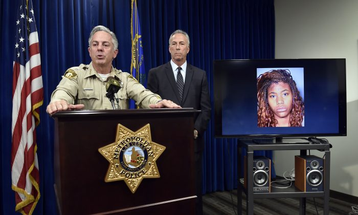 Clark County Sheriff Joe Lombardo, left, and Clark County District Attorney Steve Wolfson speak at a news conference, Monday, Dec. 21, 2015, in Las Vegas. (AP Photo/David Becker)