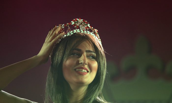 Newly crowned Miss Iraq, 20-year old Shaima Qassim, celebrates after being crowned the end of the 2015 Miss Iraq Final in Baghdad, Iraq, Saturday, Dec. 19, 2015. (AP Photo/Karim Kadim)