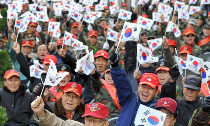Retired and former South Korean marines at a rally in downtown Seoul on Nov. 27, 2010. Countries like South Korea with a low Potential Support Ratio of workers to retirees face a serious challenge (Jung Yeon-je/AFP/Getty Images)