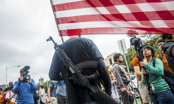 Gun activists march close to The University of Texas campus December 12, 2015 in Austin, Texas. In addition to the event put on by DontComply.com, a gun activist organization, the group also held an open carry walk earlier in the day.  (Photo by Drew Anthony Smith/Getty Images)