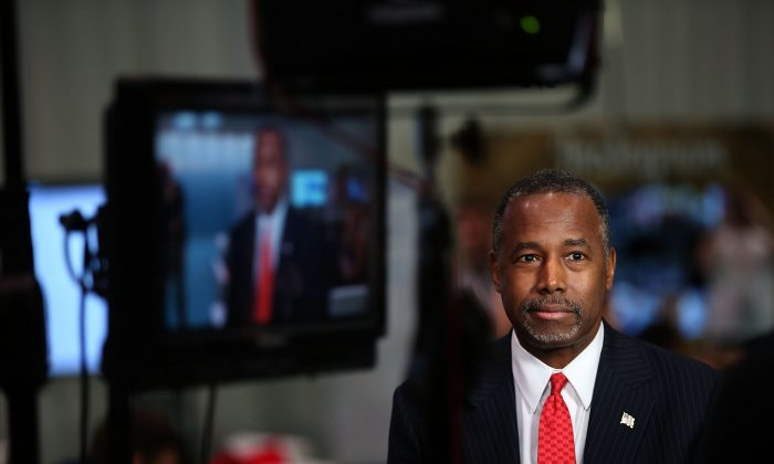 Republican presidential candidate Ben Carson prepares for a television interview before the start of the CNN republican presidential debate at The Venetian Las Vegas, in Las Vegas, Nev., on Dec. 15, 2015. (Justin Sullivan/Getty Images)