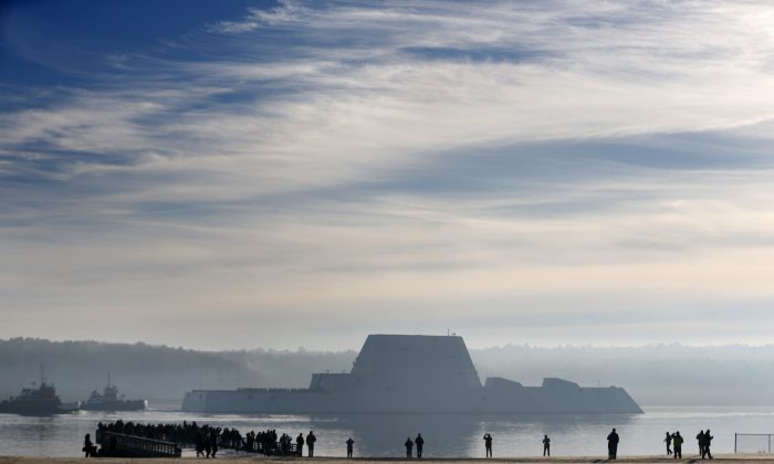 The first Zumwalt-class destroyer, the largest ever built for the U.S. Navy, heads down the Kennebec River after leaving Bath Iron Works in Bath, Maine, on Dec. 7, 2015. The ship, which has stealth capabilities, is headed out to sea for the first time to undergo sea trials. (AP Photo/Robert F. Bukaty)
