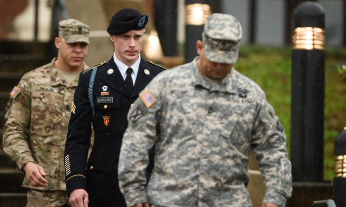 U.S. Army Sgt. Bowe Bergdahl leaves the courthouse Tuesday, Dec. 22, 2015, after his arraignment hearing at Fort Bragg, N.C. Bergdahl, who disappeared in Afghanistan in 2009 and was held by the Taliban for five years, was scheduled to appear Tuesday before a military judge on charges of desertion and misbehavior before the enemy. (Andrew Craft/The Fayetteville Observer via AP)
