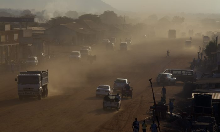 Dust is seen in the air as traffic moves along a major road under construction as the government continues to make improvements on the city's streets in Juba, South Sudan, on July 19, 2012. (Paula Bronstein/Getty Images)