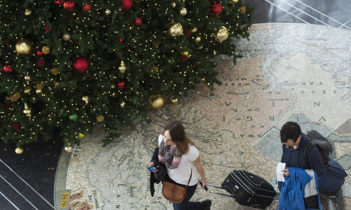 Passengers walk through the terminal as they head to their flights at Reagan National Airport in Arlington, Va., Dec. 23, 2015. (Saul Loeb/AFP/Getty Images)