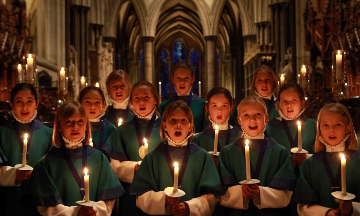 Choristers from the Salisbury Cathedral Choir practice ahead of the services held in the Cathedral marking Christmas Eve in Salisbury, England, on Dec. 23, 2009. Christmas has been celebrated in the cathedral for over 750 years since it was dedicated in 1258. It is thought that the foundation of the choir stretches back even further, with evidence of a song school in Salisbury as early as the 11th century. (Matt Cardy/Getty Images)