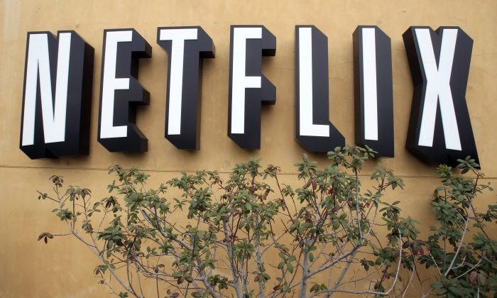 The logo of Netflix is displayed at the headquarters in Los Gatos, Calif., on April 22, 2011.  (AP Photo/Paul Sakuma)