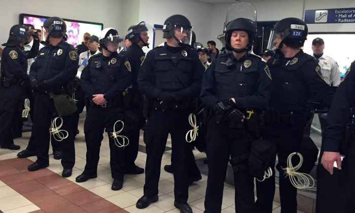 Law enforcement on the ground level tranport area at the Mall of America. A large protest that started at the Mall of America quickly migrated Wednesday, Dec. 23, 2015, to Minneapolis-St. Paul International Airport, where demonstrators blocked roads and caused significant traffic delays. (Leila Navidi/Star Tribune via AP)