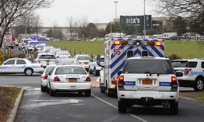 Authorities work the scene of a shooting at Northlake Mall, Thursday, Dec. 24, 2015, in Charlotte, N.C. One person was killed after an argument erupted at the mall, police said Thursday. (Robert Lahser/The Charlotte Observer via AP) MAGS OUT; TV OUT; MANDATORY CREDIT