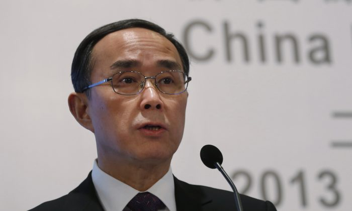 "Former Chairman of China Unicom Ltd. Chang Xiaobing speaks at a press conference to announce the company's 2013 earnings in Hong Kong on Feb. 27, 2014. The Central Committee of Discipline Inspection announced that Chang was investigated for ""severe disciplinary violations"" on Dec. 27, 2015. (AP Photo/Kin Cheung)"