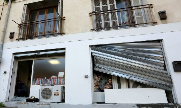 The damaged window of a Muslim prayer room in Ajaccio, on the French Mediterranean island of Corsica, Saturday, Dec. 26, 2015.  A crowd vandalized a Muslim prayer room in Corsica a day after an ambush left firefighters injured on the French island. (AP Photo/Jean-Pierre Belzit)
