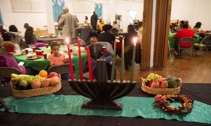 A kinara, which means candle holder in Swahili, at the back of a Kwanzaa celebration in Newburgh on Dec. 27, 2015. A Kinari holds seven candles, one for each day of Kwanzaa, with three red, three green and one black candle in the colors of Kwanzaa. (Holly Kellum/Epoch Times)