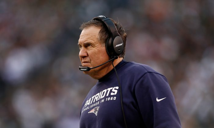 Bill Belichick has won four Super Bowls with the New England Patriots and can survive a gaffe like kicking the ball to start overtime. (Jeff Zelevansky/Getty Images)
