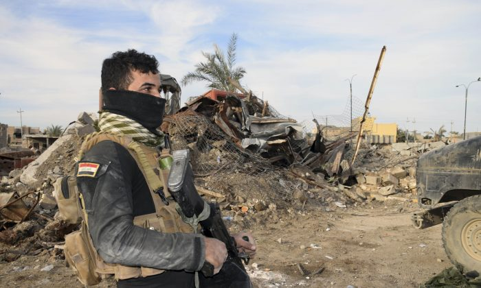 Iraqi Security forces enter the heavy damaged downtown Ramadi, 70 miles (115 kilometers) west of Baghdad, Iraq, on Dec. 27, 2015. (AP Photo)