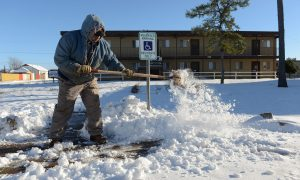 Large Storm Brings Twisters, Floods, Now Snow and Ice