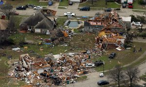 Texas Cleans Up After Twisters, Snow and Ice Pelt Midwest