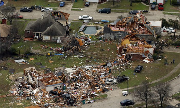 This aerial photo shows damage after a tornado ripped through the area in Glenn Heights, Texas, on Dec. 28, 2015. Residents surveyed the destruction from deadly tornadoes in North Texas as the same storm system brought winter woes to the Midwest on Monday, amplifying flooding that's blamed for more than a dozen deaths and prompting hundreds of flight cancellations. At least 11 people died and dozens were injured in the tornadoes that swept through the Dallas area Saturday and caused substantial damage. (G.J. McCarthy/The Dallas Morning News via AP)
