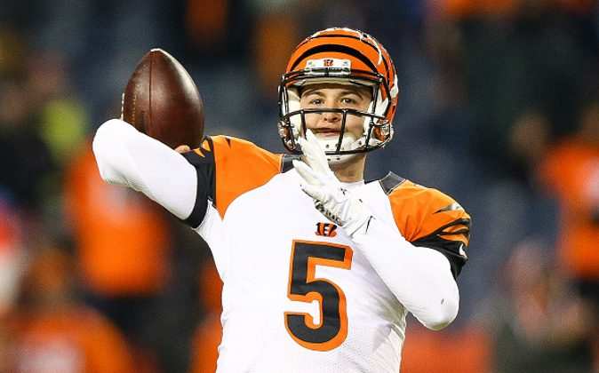 Quarterback AJ McCarron #5 of the Cincinnati Bengals throws as he warms up before a game against the Denver Broncos at Sports Authority Field at Mile High in Denver, Colo, on Dec. 28, 2015. (Justin Edmonds/Getty Images)