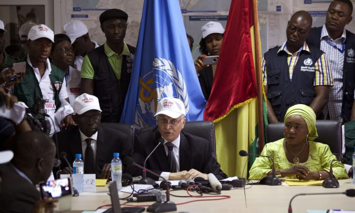 Mohamed Belhocine (C), a representative from World Health Organization (WHO), at a press briefing in Conakry City, Guinea, on Dec. 29, 2015. Guinea has been declared free from transmission of Ebola, WHO said Tuesday, marking a milestone for the West African country where the original Ebola chain of transmission began two years ago leading to the largest epidemic in history. (AP Photo/Youssouf Bah)