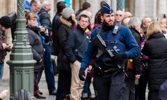 An armed police man patrols at the Grand Place in Brussels on Tuesday, Dec. 29, 2015.  (AP Photo/Geert Vanden Wijngaert)