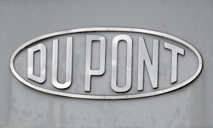 The DuPont logo is seen on a sign at the entrance to the company's Spruance Plant in Richmond, Va., on April 22, 2008. DuPont said Tuesday, Dec. 29, 2015, it will cut 1,700 jobs in its home state of Delaware and thousands more globally as it prepares for its merger with Dow Chemical. (AP Photo/Steve Helber)